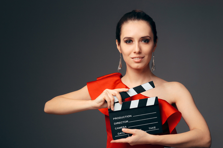 Elegant Actress in Red Dress Holding Cinema Clapboard