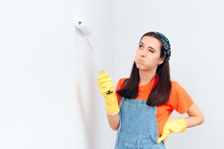 Tired Woman Painting White Wall with Paint Roller