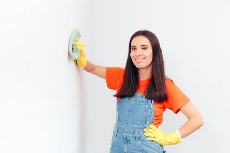 Woman Cleaning Washable Paint in House Cleaning Session Banco de Imagens