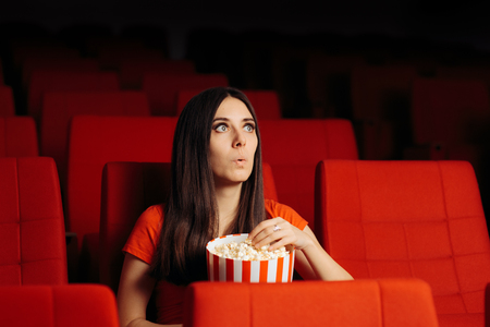 Funny Girl with Popcorn Watching Movie in Cinema Theatre