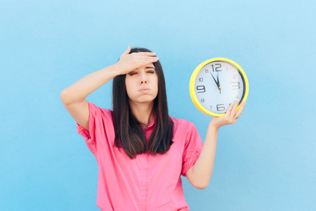 Forgetful Woman Holding a Clock on a Blue Background