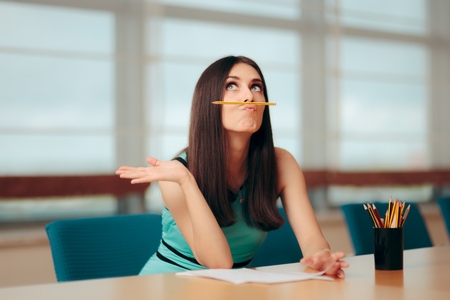 Funny Bored Girl Playing with Pencil At Business Meeting