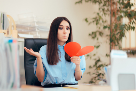 Office Woman Receiving Valentine Card from Secret Admirer Banco de Imagens