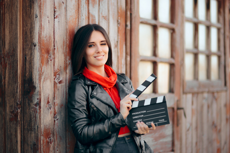 Young Actress Holding Cinema Board Waiting to Film Stock Photo - 115768835