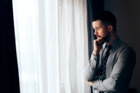 Man Looking out the Window Thinking of the Future