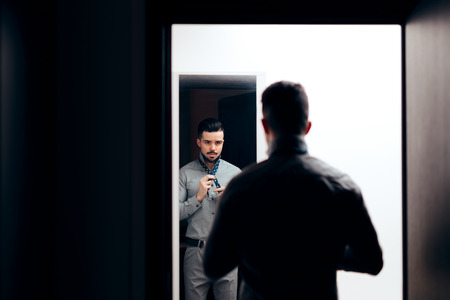 Handsome Elegant Man Looking in the Mirror