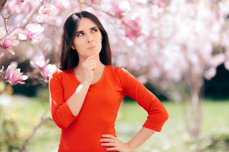 Funny Girl Planning and  Thinking Under Magnolia Tree Banque d'images - 118435663