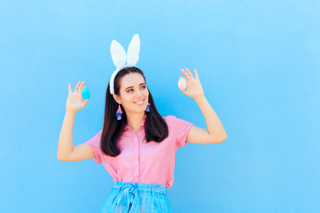 Funny Girl with Bunny Ears Holding Easter Eggs