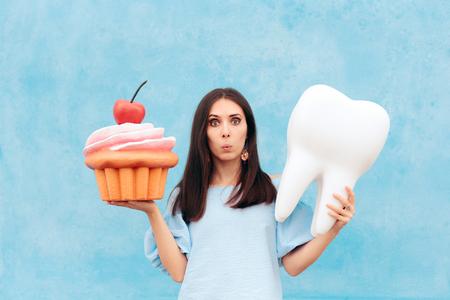 Mujer divertida con diente y cupcake grande
