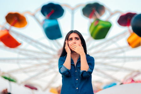 Woman Having Motion Sickness on Spinning Ferris Wheel Background Stockfoto