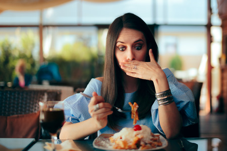 Woman Feeling Sick While Eating Huge Meal