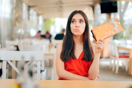 Curious Woman Checking Gift Box on a Date Imagens