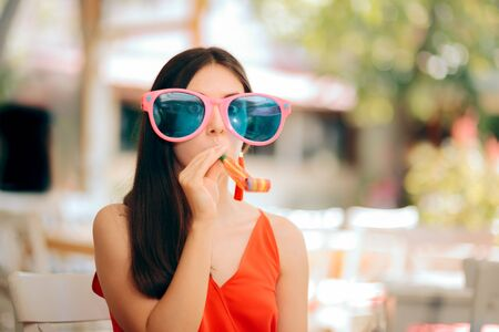Funny Woman with Party Horn Blower and Oversized Sunglasses