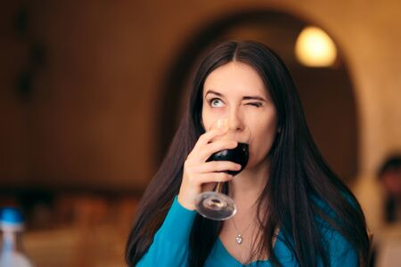 Funny Woman Drinking Wine Glass at the Restaurant