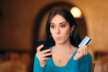 Woman Holding Credit Card and Smartphone Shopping Online