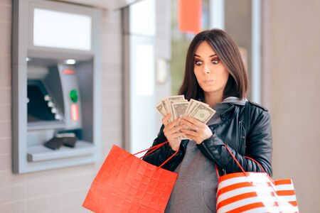 Cheerful Pregnant Woman Holding Money at the ATM