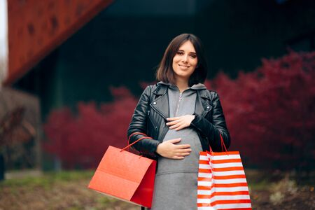 Pregnant Woman with Shopping Bags Buying Baby Stuff 写真素材
