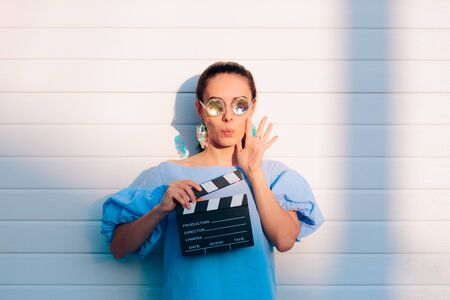 Cool Actress Holding Movie Clapper Ready to Film Stockfoto