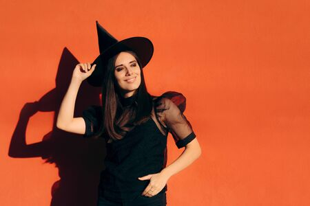 Halloween Woman in Witch Costume Outdoors Portrait 写真素材