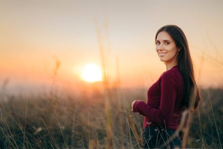 Fashion Portrait of a Happy Woman Admiring Sunset Stock fotó