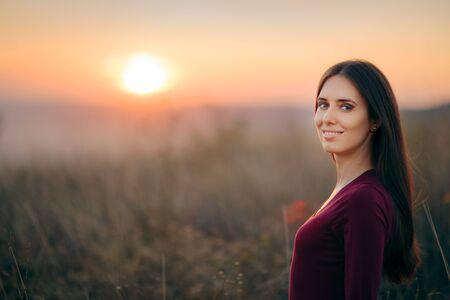 Fashion Portrait of a Happy Woman Admiring Sunset Stockfoto
