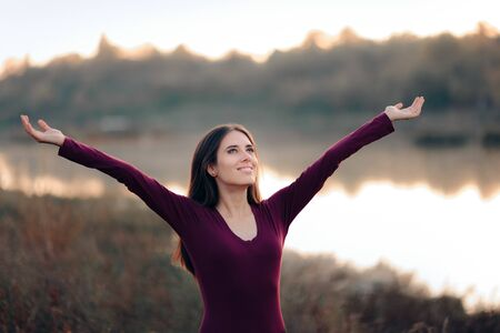 Happy Woman with Arms Up Enjoying Freedom in Nature Reklamní fotografie