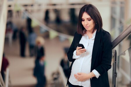 Happy Pregnant Businesswoman Checking her Smartphone