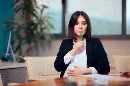 Pregnant Woman Signing Maternity Leave Papers at Work