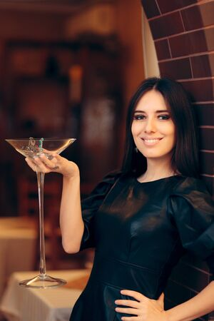 Woman Holding Giant Champagne  Glass Filled with Jewelry