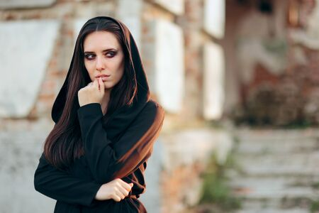 Mysterious Evil Vampire in Front of a Horror Abandoned House