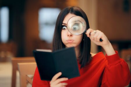 Funny Woman Checking Restaurant Bill with a Magnifying Glass