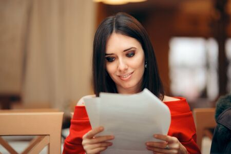 Woman Reading Document Papers in a Restaurant Stok Fotoğraf