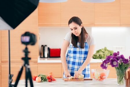 Female Food Vlogger Filming a Cooking Video in her Kitchen