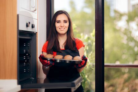 Woman Admiring her Delicious Cupcake fresh of the Oven