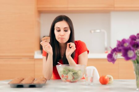 Woman Eating a Cupcake instead of Apples or Salad Stok Fotoğraf