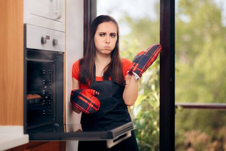 Woman Failing at Baking Some Muffins in the Oven