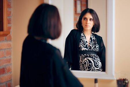 Introspective Pregnant Woman Analyzing Herself in a Mirror Stock fotó