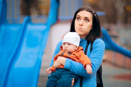 Tired Exhausted Mother Holding her Baby on a Playground Reklamní fotografie - 134940309