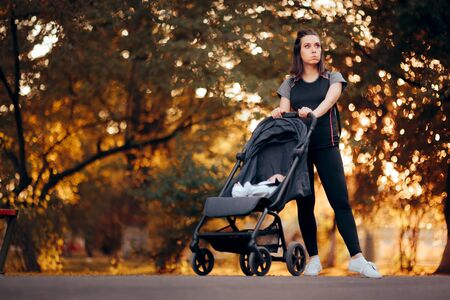 Funny Mother Wearing Sporty Outfit Pushing Stroller in the Park Stock fotó