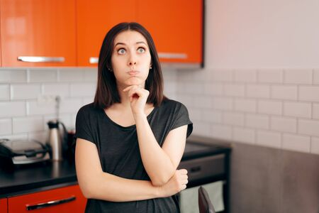 Funny Woman in the Kitchen Thinking what to Eat