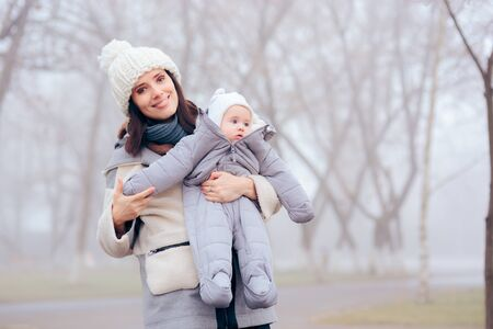 Mother Taking Baby Out for a Walk in Winter