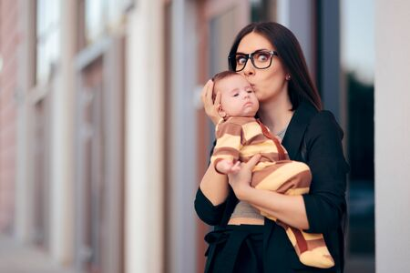 Elegant Woman in Business Suit Holding Her Baby