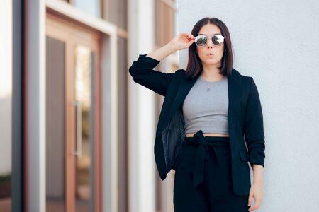 Fashion Woman Wearing Silver Sunglasses and Jacket Фото со стока