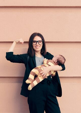 Strong Woman in Business Outfit Holding Baby