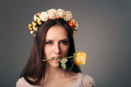 Woman Wearing Flower Crown Holding Rose in her Mouth