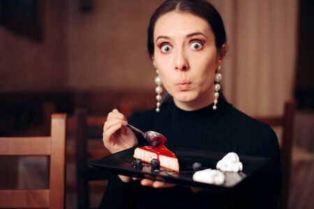 Funny Woman Eating Sweet Cake in a Restaurant