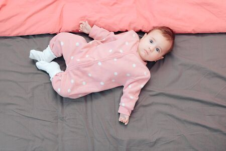 Cute Little Baby Girl Wearing Polka Dot Pink Pajamas 版權商用圖片