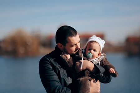 Loving Father Holding Adorable Baby Girl Standard-Bild