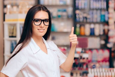 Smiling Pharmacist Standing Holding Thumbs Up