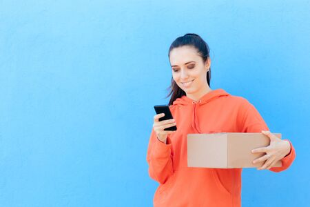 Woman Checking Her Smartphone Holding Delivery Parcel Box